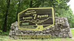 Stock Video Footage of Arkansas Ouachita Scenic 7 By Way near Hot Springs forest sign