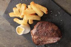 plated cooked steak dinner meal - stock photo