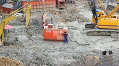 Stock Video Footage of busy working site city centre construction machinery excavator people workers 4k