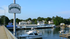 Kittery Maine sign of Welcome and marina with boats on bridge old town settled Stock Footage