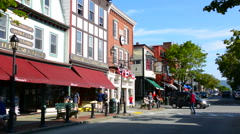 Bar Harbor Maine Main Street traffic and shops with tourists and fall color Stock Footage