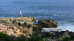 Acadia National Park near Bar Harbor Maine rocks with tourists at Thunder Hole - stock footage