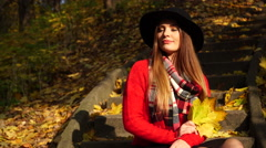 Woman relaxing in autumn fall park steadicam 4K. Stock Footage