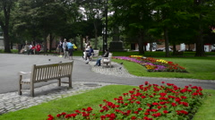 Canada Saint John New Brunswick Kings Square with flowers and relaxing locals in Stock Footage