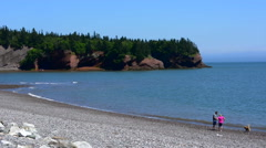 Canada St Martins New Brunswick couple on beach called Macs Beach in the Fundy Stock Footage