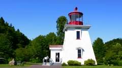 Canada St Martins New Brunswick white tourist lighthouse in small fishing and Stock Footage