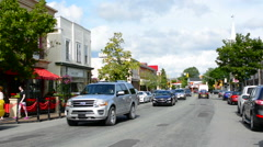 Canada Antigonish Nova Scotia traffic and shops on Main Street with cars and Stock Footage