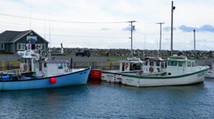 Canada Cape George Nova Scotia harbour boats fishing vessels lobster fish Stock Footage