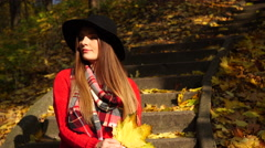 Woman relaxing in autumn fall park steadicam 4K. - stock footage