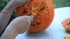 Using different tools on a Halloween pumpkin Stock Footage