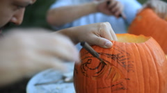 Carving Halloween pumpkins outside Stock Footage