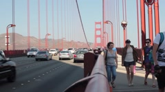 People and traffic on the Golden Gate Bridge Stock Footage