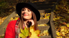 Woman relaxing in autumn fall park 4K. - stock footage