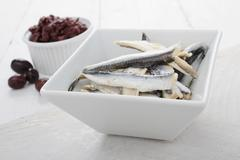 Olives and anchovies canape tapas - stock photo
