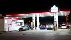 One side of Petro Canada gas station at night Stock Footage