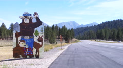 Smokey the bear mascot, California highway Stock Footage