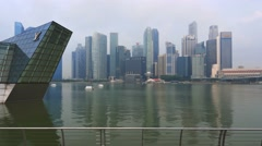 Singapore skyline cityscape bay tracking shot steady cam slow Stock Footage