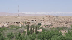Moroccan city near atlas mountains - stock footage
