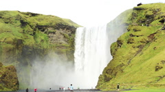 Skogafoss, Iceland scenic waterfall with tourists - stock footage