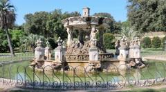 Man running around a fountain, villa doria pamphilj, rome Stock Footage