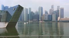 Singapore skyline cityscape bay tracking shot steady cam Stock Footage