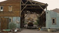 Eldorado Canyon mine tours. Old school bus. Garage with junk - stock footage