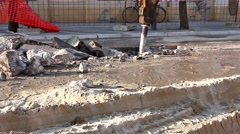 Hydraulic jack hammer is breaking concrete road Stock Footage