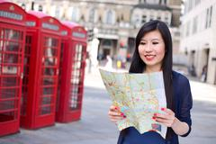 Japanese tourist in London reading a map Stock Photos