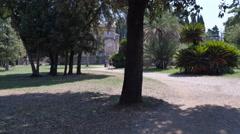 Man jogging in the park watching his watch,Villa Doria Pamphilj,rome Stock Footage