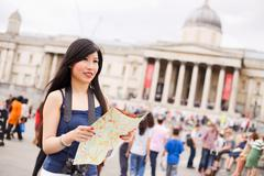 Japanese tourist in Trafalgar square holding a map Stock Photos