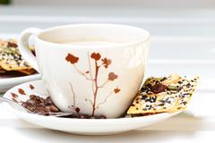 Cup of coffee with crackers. - stock photo