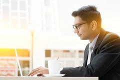 Business man browsing internet at cafe - stock photo