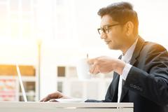 Business man using internet at cafe - stock photo