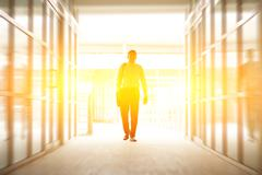 Business people walking thru modern office - stock photo