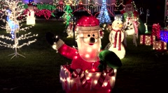 4K Christmas Santa yard display waves hello Stock Footage