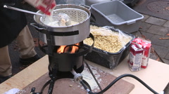 Macaroni and cheese cooking over fire at college campus Stock Footage