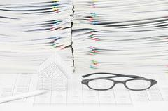 Silver pen and house with spectacles on finance account Stock Photos