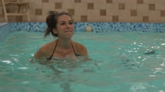 Pregnant woman running in water in aquafit class Stock Footage