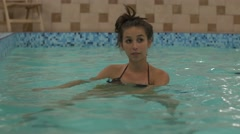 Pregnant woman doing aquafit class Stock Footage