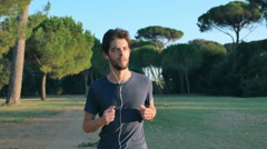 Young man goes jogging in the middle of nature Stock Footage