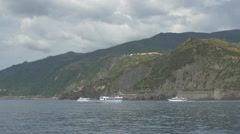 White boats sailing on the sea in Cinque Terre Stock Footage