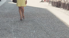 Confident woman walks on courtyards of Milan Stock Footage