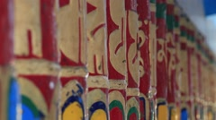 Buddhist prayer wheels in Tibetan monastery. India, Dharamsala Stock Footage