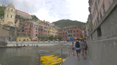 Walking and taking pictures on Via Visconti in Vernazza, Cinque Terre Stock Footage