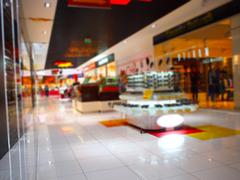Interior of the shopping center with shops of fashionable clothes Stock Photos