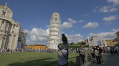 Taking pictures and selfies with the Leaning Tower of Pisa in Pisa Stock Footage