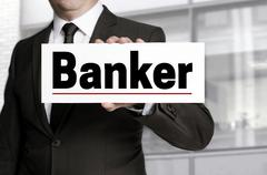 Banker sign is held by businessman concept - stock photo