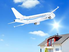 Airplane over house Stock Illustration