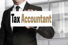 Tax accountant sign is held by businessman concept - stock photo