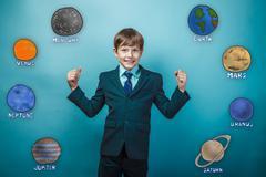 Teen boy businessman grins and shows its strength hands joyful p Stock Photos